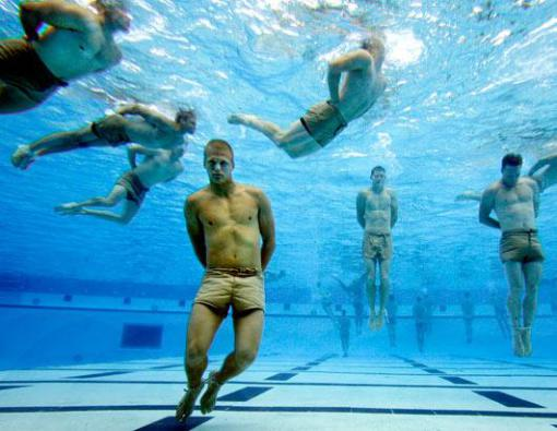 Navy Seal trainees from class 259 bounce off the bottom of the tank to catch their breath during a Drown Proofing Test at the Combat Training Tank in this undated file photo. (Lance Iversen/San Francisco Chronicle/Corbis)
